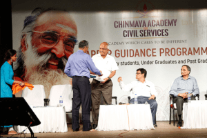 Giving special gifts to chief guests at Chinmaya IAS Academy