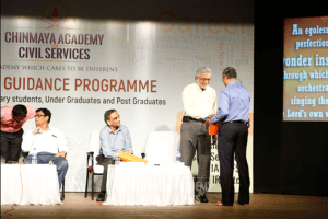 Faculty member getting special gift at the career guidance program of Chinmaya IAS Academy