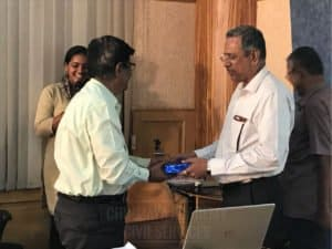 Faculty member receiving special gift from another member at Chinmaya IAS Academy
