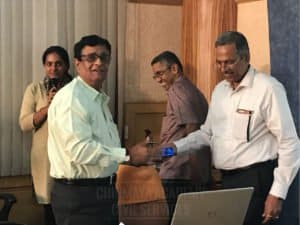 Faculty member giving special gift to another member at Chinmaya IAS Academy