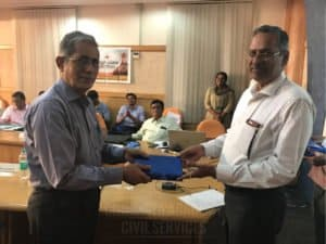 Faculty member getting special gift from another member at Chinmaya IAS Academy guest lecture
