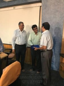 Chinmaya IAS Academy faculty giving special gift to guest lecturer