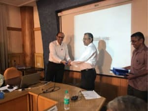 Guest lecturer receiving special gifts at Chinmaya IAS Academy