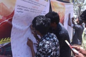 Students signing in the signature campaign poster coordinated by Chinmaya IAS Academy