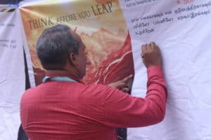 Faculty signing the poster of signature campaign conducted by chinmaya IAS Academy, Chennai