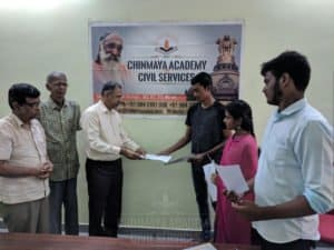 Faculty members giving admission forms to IAS aspirants at Chinmaya IAS Academy in Chennai