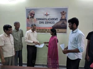 A woman candidate getting admission form from Chinmaya IAS Academy, Chennai
